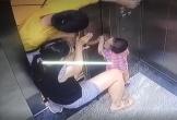 Mải xem điện thoại, mẹ để con nhỏ bị kẹt tay vào cửa thang máy