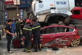 Dừng chờ đèn đỏ, ô tô con bị xe container chồm lên nóc, 3 người tử vong